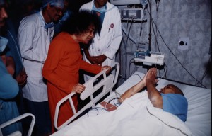 Swami speaking to a patient in ICU