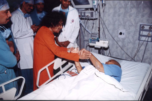 Swami blessing a patient
