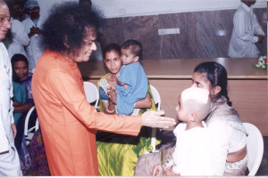 Swami Blessing a child after Neurosurgery