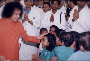 Swami blessing a small child